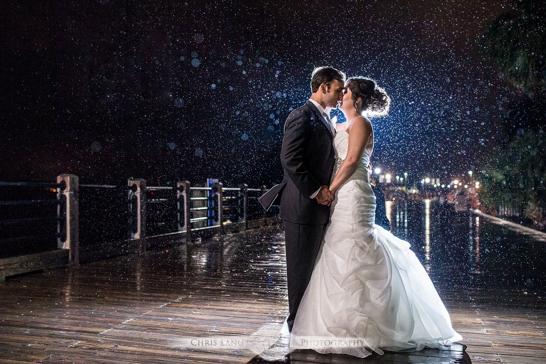 Nighttime wedding photography low light wedding photography wedding picture bride groom in the rain wilmington hilton riverside wedding junglespirit Images