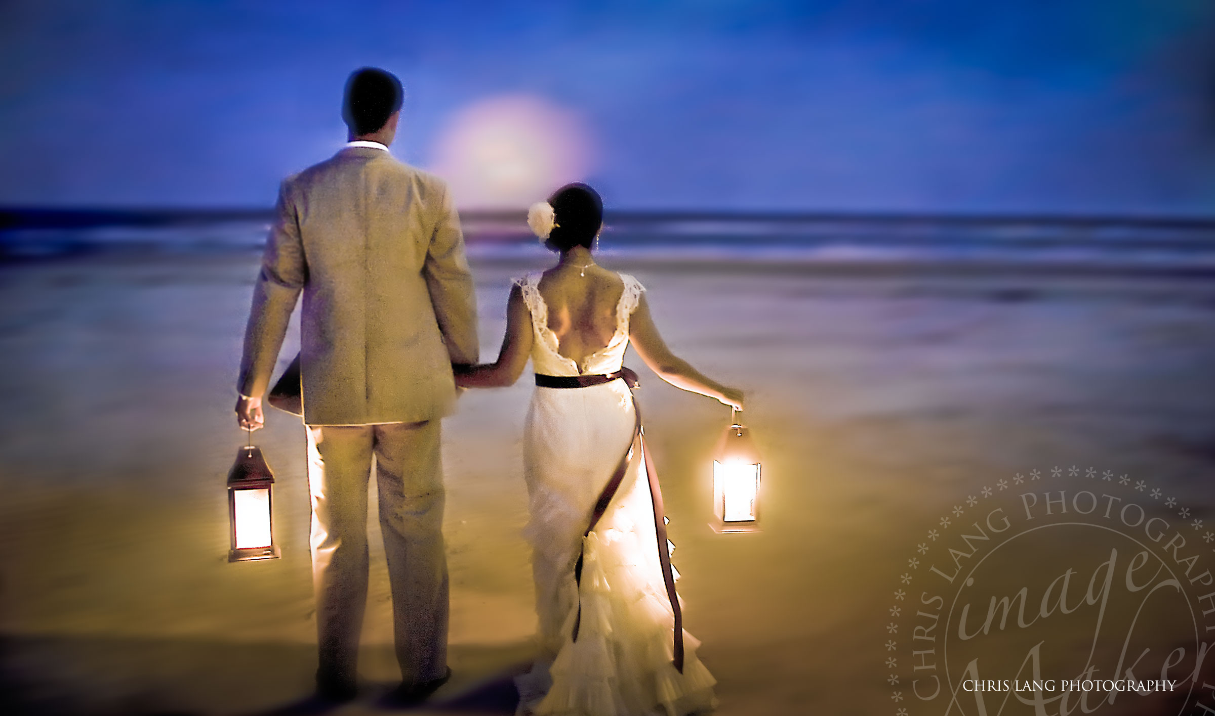 creative wedding picture of bride and groom holding lanterns on the beach wilmington nc photographer