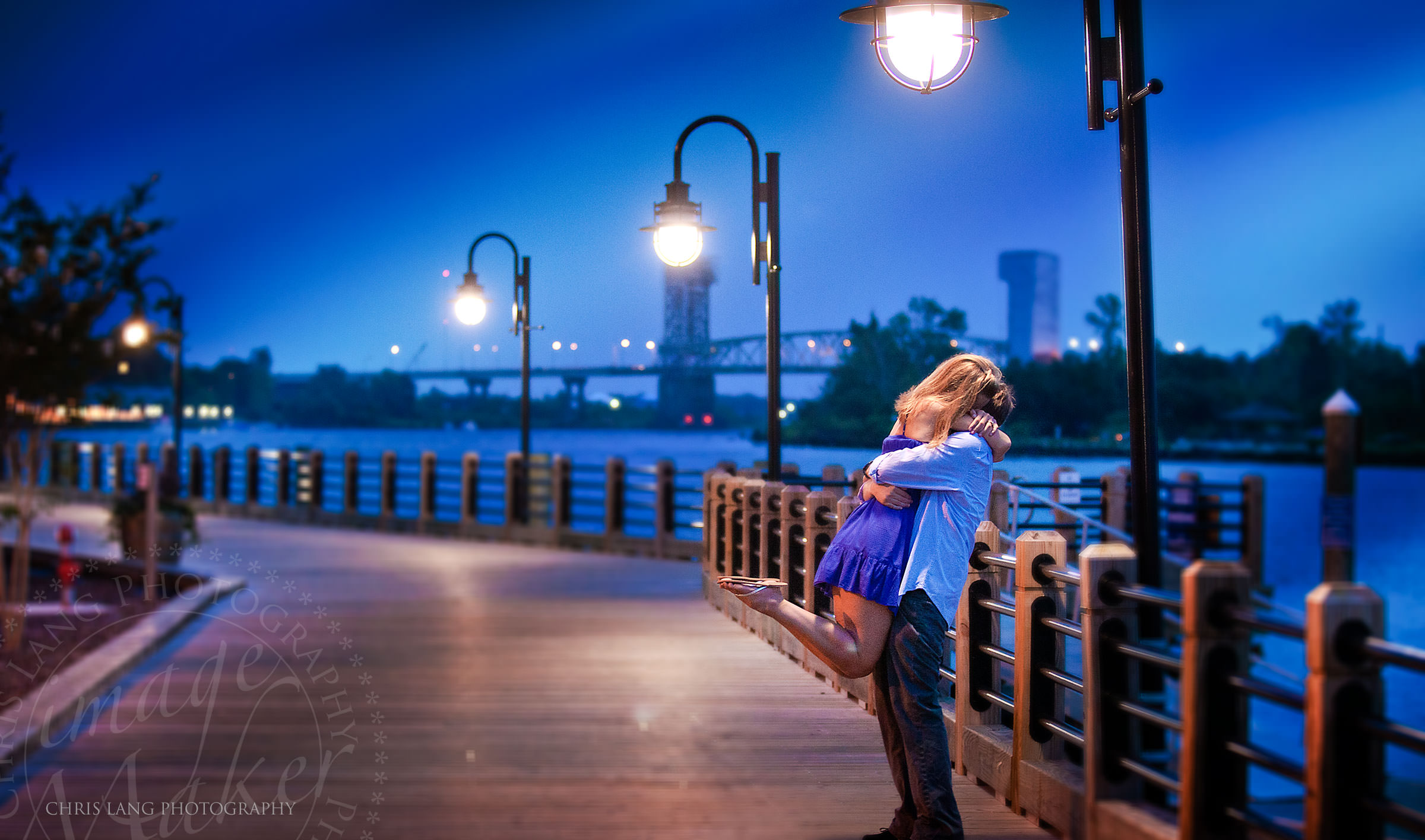 Image of engaged couple on the Cape Fear River Deck - Wilmington NC Engagement Photographers & The Art of Weddings | Lifestyle Wedding Photography | Chris Lang ... azcodes.com