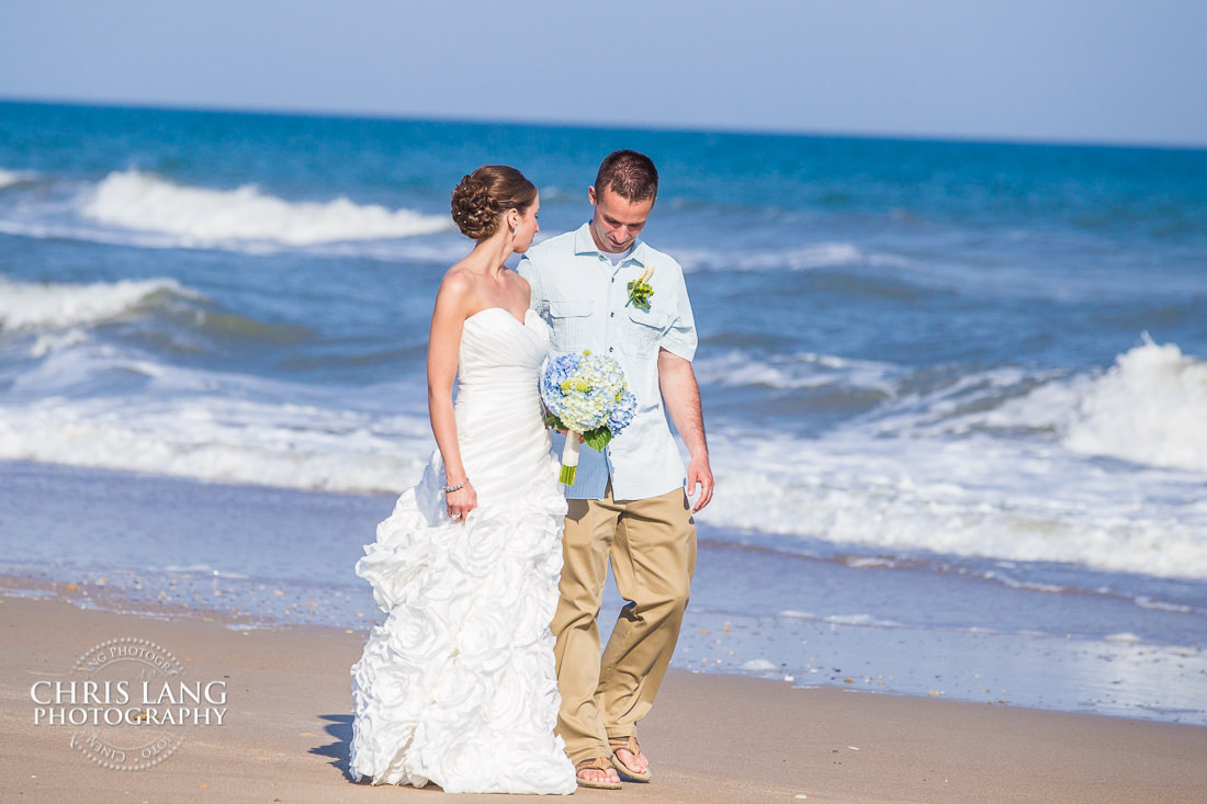 Bride And Groom Walking Ont He Beach Oak Island Wedding Photographers