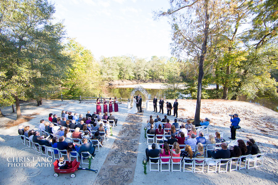 image of wedding ceremony at the RIver Lodge - RIver Landing Wallace NC