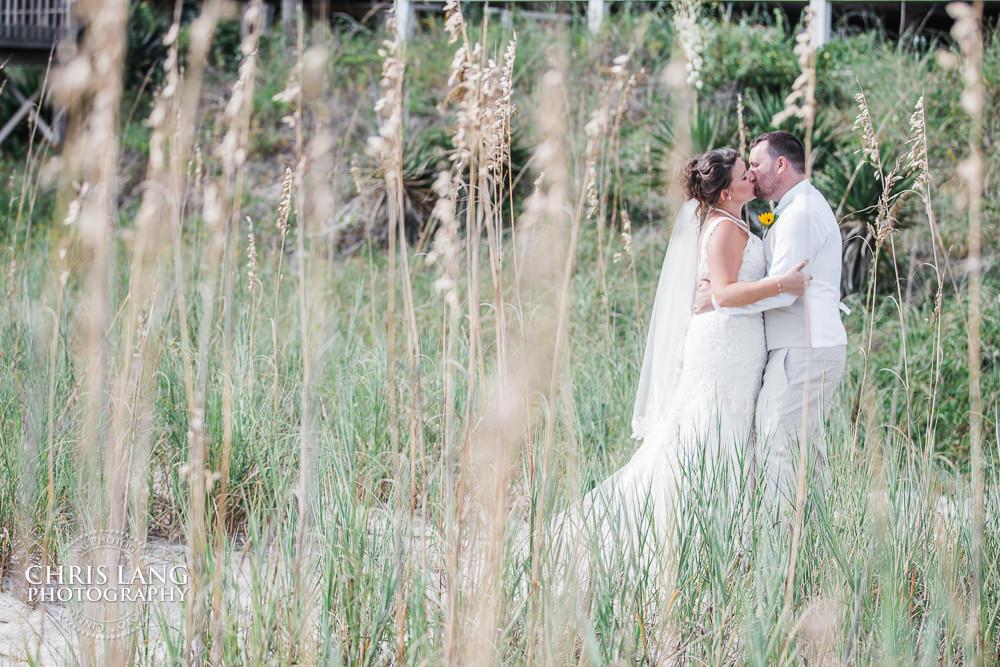 Bride Groom Kissing Beach Sea Oats Wrightsville North Carolina Wedding